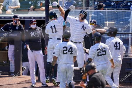 New York Yankees' Brett Gardner (11) celebrates his grand slam home run off Philadelphia Phillies starting pitcher Zack Wheeler, with Aaron Judge, right center, and manager Aaron Boone, second from left, during the second inning of a spring training exhibition baseball game against the Philadelphia Phillies at George M. Steinbrenner Field in Tampa, Fla