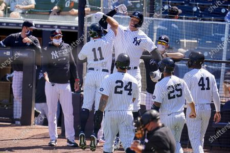 New York Yankees' Brett Gardner (11) celebrates his grand slam home run off Philadelphia Phillies starting pitcher Zack Wheeler, with Aaron Judge, right center, and manager Aaron Boone, left, during the second inning of a spring training exhibition baseball game against the Philadelphia Phillies at George M. Steinbrenner Field in Tampa, Fla