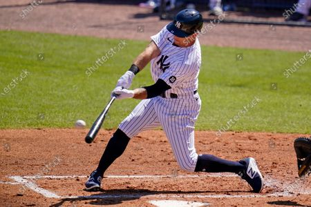 Stock Picture of New York Yankees' Brett Gardner (11) hits a grand slam off Philadelphia Phillies starting pitcher Zack Wheeler during the second inning of a spring training exhibition baseball game at George M. Steinbrenner Field in Tampa, Fla
