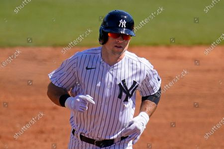 New York Yankees' Brett Gardner rounds second after hitting a grand slam home run off Philadelphia Phillies starting pitcher Zack Wheeler during the second inning of a spring training exhibition baseball game at George M. Steinbrenner Field in Tampa, Fla