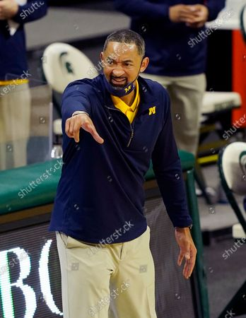 Michigan head coach Juwan Howard points on the sideline during the second half of an NCAA college basketball game against Michigan State, in East Lansing, Mich