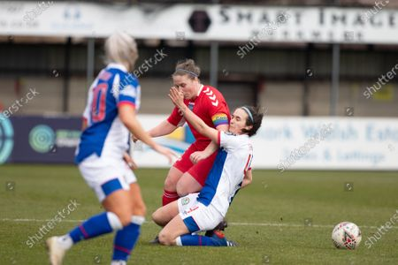 Natasha Fenton (#4 Blackburn Rovers) tackles Sarah Wilson (#5 DURHAM) during the FA Womens Championship League game between Blackburn Rovers and Durham at the Sir Tom Finney Stadium in Bamber Bridge, England.