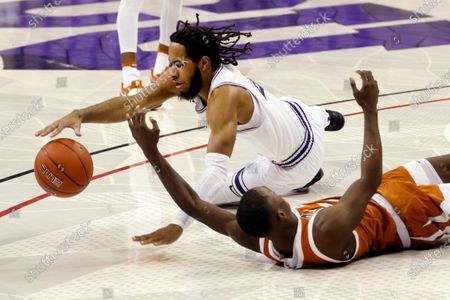 Stock Photo of Guard PJ Fuller (4) goes after the ball in front of Texas guard Andrew Jones, bottom, during the first half of an NCAA college basketball game in Fort Worth, Texas