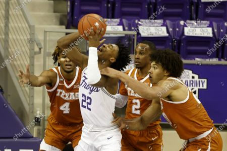 Texas forward Jericho Sims, right, fouls TCU guard RJ Nembhard (22) as Texas forward Greg Brown (4) and guard Matt Coleman III (2) defend during the first half of an NCAA college basketball game in Fort Worth, Texas