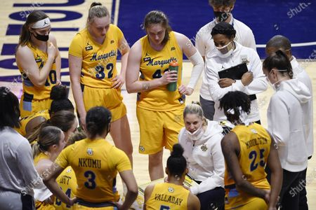 Marquette's Megan Duffy talks to her team during the second half of an NCAA college basketball game against Creighton in the Big East tournament semifinals at Mohegan Sun Arena, in Uncasville, Conn