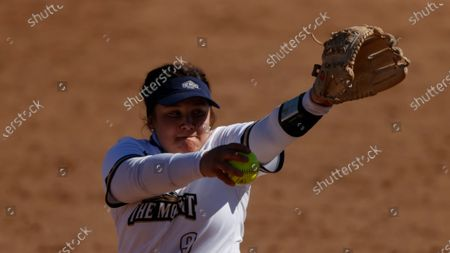 Mount St. Mary's pitcher Elizabeth King throws against George Washington during an NCAA softball game, in Emmitsburg, Md