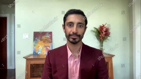 A handout screen shot made available by Getty Images shows British actor Riz Ahmed speaking during the 26th Annual Critics Choice Awards from an unspecified location, 07 March 2021.