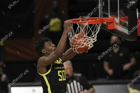 Oregon's Eric Williams Jr. (50) dunks against Oregon State during the second half of an NCAA college basketball game in Corvallis, Ore