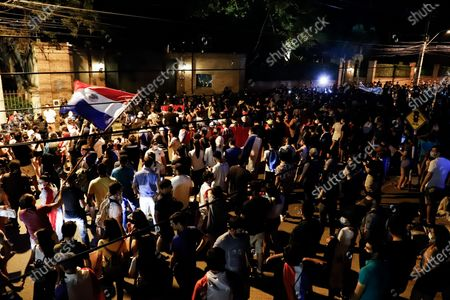 A crowd gathers around the presidential residence and in front of the residence of former President Horacio Cartes, to call for the resignation of President Mario Abdo Benitez, criticized for his management of the COVID-19 pandemic and the collapse of the health system, in Asuncion, Paraguay, 07 March 2021.