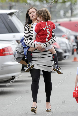 Stock Picture of Rio Ferdinand's wife Rebecca Ellison and son Lorenz.