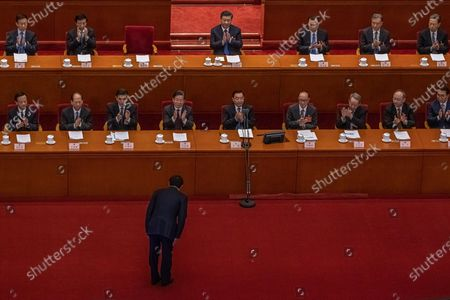 Li Zhanshu (front), National People's Congress Chairman bows in front of Chinese President Xi Jinping (C), Premier Li Keqiang (C-R) and other delegates, before delivering a speech during the second plenary session of the National People's Congress (NPC) at the Great Hall of the People, in Beijing, China, 08 March 2021. China holds two major annual political meetings, The National People's Congress (NPC) and the Chinese People's Political Consultative Conference (CPPCC) which run alongside and together known as 'Lianghui' or 'Two Sessions'.