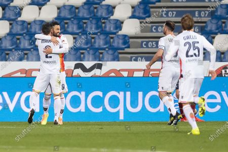 Massimo Coda of US Lecce celebrates after scoring his team's third goal with his teammate Christian Maggio  during the Serie B match between AC Reggiana and US Lecce at Mapei Stadium - Citt del Tricolore on March 7, 2021 in Reggio Emilia, Italy.