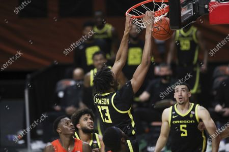 Oregon's Chandler Lawson (13) dunks against Oregon State during the second half of an NCAA college basketball game in Corvallis, Ore