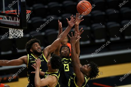 Oregon's L.J. Figueroa, left, Chandler Lawson, center back, Eric Williams Jr., right, and Will Richardson, front, grab for a rebound during the first half of an NCAA college basketball game in Corvallis, Ore