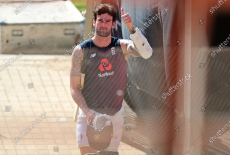 England's Reece Topley gestures towards the photographers as he arrives for a training session ahead of the first Twenty20 cricket match between India and England in Ahmedabad, India