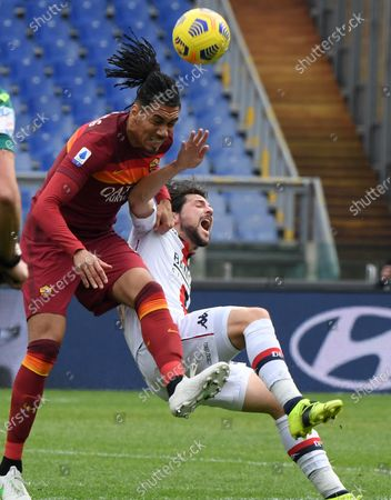 Roma's Chris Smalling (L) vies with Genoa's Mattia Destro during a Serie A football match between Roma and Genoa in Rome, Italy, March 7, 2021.