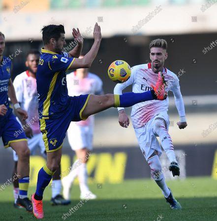AC Milan's Samuel Castillejo (R) vies with Hellas Verona's Miguel Veloso during a Serie A football match between Hellas Verona and AC Milan in Verona, Italy, March 7, 2021.