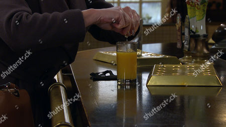 Stock Image of Emmerdale - Ep 8991 Thursday 11th March 2021 - 1st Ep At the pub, aware Dawn has a meeting with the social worker, Kim Tate, as played by Claire King, creates a distraction, allowing her to spike Dawn's drink. Could this could blow her chances of getting Lucas back?
