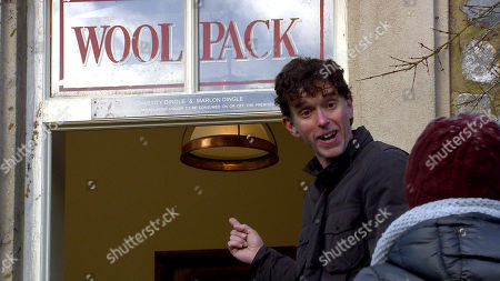 Emmerdale - Ep 8999 Friday 19th March 2021 Marlon Dingle, as played by Mark Charnock, and Rhona Goskirk are proud as they look at his name above the Woolpack door.