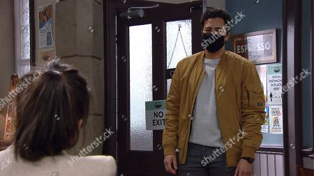 Stock Photo of Emmerdale - Ep 8988 Monday 8th March 2021 Ellis Grant, as played by Aaron Anthony, questions Priya Sharma's, as played by Fiona Wade, motives and tells Priya it wouldn't work between them.