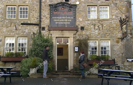 Emmerdale - Ep 8999 Friday 19th March 2021 Marlon Dingle, as played by Mark Charnock, and Rhona Goskirk, as played by Zoe Henry, are proud as they look at his name above the Woolpack door.