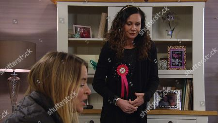 Stock Picture of Emmerdale - Ep 8998 Thursday 18th March 2021 - 2nd Ep Charity Dingle, as played by Emma Atkins, finalises the sale of her share of the pub to Marlon Dingle - putting on a brave face. Soon she is summoned to sign the paperwork, Chas Dingle, as played by Lucy Pargeter, is relieved but Charity can't hide her sadness.