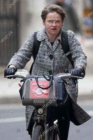 Stock Image of Head of the NHS Test and Trace programme Baroness Dido Harding cycles in Westminster.