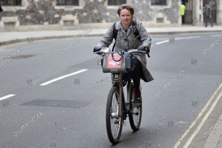 Head of the NHS Test and Trace programme Baroness Dido Harding cycles in Westminster.