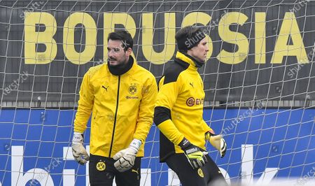 Stock Picture of Dortmund's goalkeepers Roman Buerki, left, and Marvin Hits, right, exercise during a training session prior the Champions League round of 16 second leg soccer match between Borussia Dortmund and Sevilla FC in Dortmund, Germany