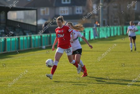 Stock Picture of Lois Heuchan (#25 Charlton Athletic) under pressure from Emma Jones (#7 Lewes)