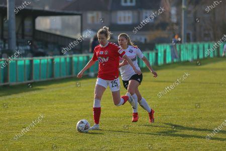 Lois Heuchan (#25 Charlton Athletic) under pressure from Emma Jones (#7 Lewes)