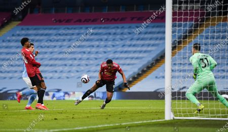 Anthony Martial of Manchester United heads a shot at goal