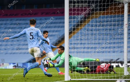 Anthony Martial of Manchester United heads a shot at goal which is saved by Ederson goalkeeper of Manchester City