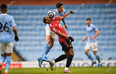 Anthony Martial of Manchester United and John Stones of Manchester City