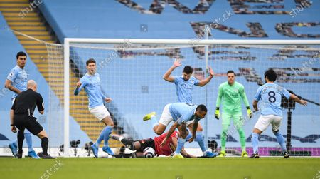 Gabriel Jesus of Manchester City fouls Anthony Martial of Manchester United who is awarded a penalty