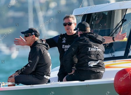 Defender's  Emirates Team New Zealand (ETNZ), skippered by Peter Burling on Te Rehutai and Italian challengers Luna Rossa Prada Pirelli, co-helmed by Jimmy Spithill and Francesco Bruni on Luna Rossa, during Day 3, Race 6, of the 36th America's Cup.  At left ETNZ CEO watches the boat as support staff gesture after the team won the race to equal the series 3-3.