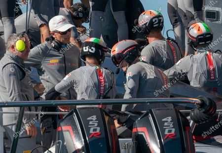 Italian challengers Luna Rossa Prada Pirelli, co-helmed by Jimmy Spithill and Francesco Bruni on Luna Rossa,  with tactician Pietro Sibello and Gilberto Nobilli listen to coaches Vascoe Vizconi (let) and Philippe Presti between races on Day 3 of the 36th America's Cup.