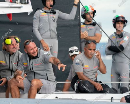Due to light winds on Day 4 of the 36th America's Cup racing was postponed. Luna Rossa Prada Pirelli crew wait for wind as as Aucklanders surround them on a variety of craft much to the amusement of the team. Max Sirena (2nd left), Vascoe  Vizconi (left) and co-helmsman Francesco Bruni (top) enjoy the spectators antics with team mates.