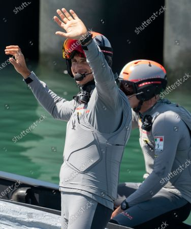 Italian challengers Luna Rossa Prada Pirelli, co-helmed by Jimmy Spithill (right) and Francesco Bruni (left) wave to supporters as they leave the dock on Day 5 of the 36th America's Cup.