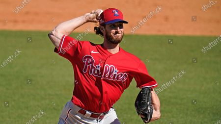 Philadelphia Phillies pitcher Bryan Mitchell delivers during a spring training exhibition baseball game against the New York Yankees at George M. Steinbrenner Field in Tampa, Fla