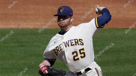 Milwaukee Brewers starting pitcher Brett Anderson (25) throws during the first inning of a spring training baseball game against the Chicago Cubs, in Scottsdale, Ariz