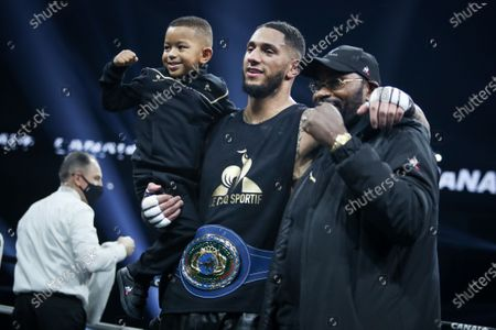 French boxer Tony Yoka and his son after his fight against Belgian boxer Joel Tambwe Djeko for the european union heavyweight title in H Arena in Nantes