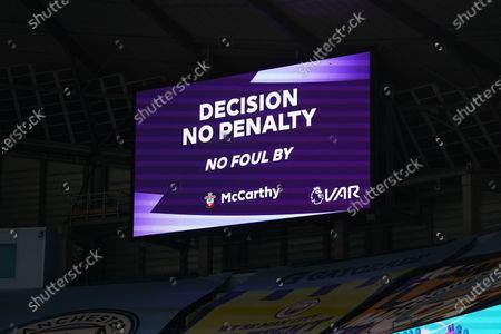 VAR Referee Andy Madley checks for a penalty on Phil Foden of Manchester City by Goalkeeper Alex McCarthy of Southampton but gives no penalty