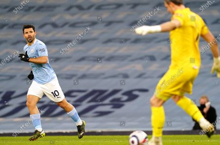Stock Image of Sergio Aguero of Manchester City watches as Goalkeeper Alex McCarthy of Southampton brings the ball out