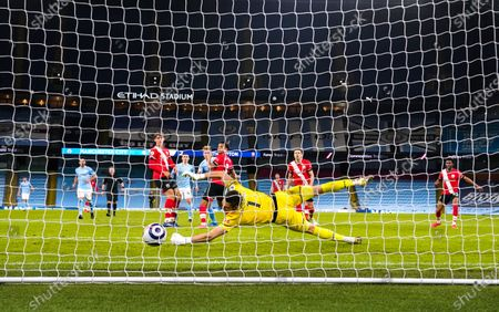Stock Picture of Kevin De Bruyne of Manchester City scores the fifth goal 5-2 past the despairing Goalkeeper Alex McCarthy of Southampton