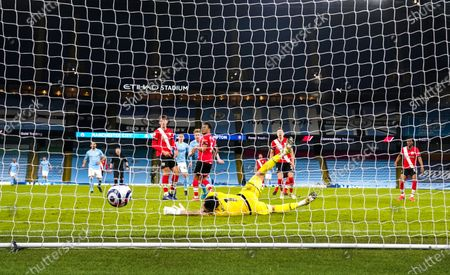 Stock Photo of Kevin De Bruyne of Manchester City scores the fifth goal 5-2 past the despairing Goalkeeper Alex McCarthy of Southampton