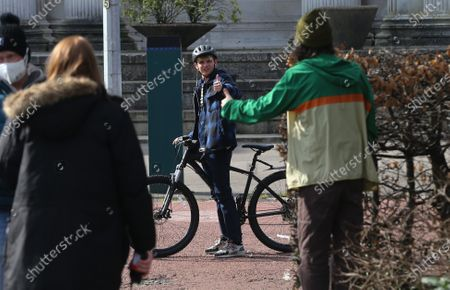 Stock Picture of Actor Otto Farrant, who plays the title role in Alex Rider, on his bike along with co-star Brenock O'Connor who plays Tom Harris, during filming of the second series of the Amazon Prime series in Cardiff