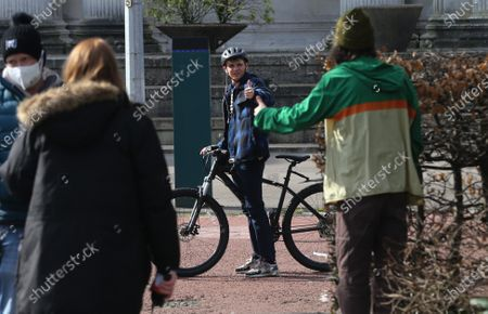 Stock Image of Actor Otto Farrant, who plays the title role in Alex Rider, on his bike along with co-star Brenock O'Connor who plays Tom Harris, during filming of the second series of the Amazon Prime series in Cardiff
