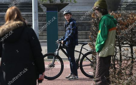 Stock Photo of Actor Otto Farrant, who plays the title role in Alex Rider, on his bike along with co-star Brenock O'Connor who plays Tom Harris, during filming of the second series of the Amazon Prime series in Cardiff