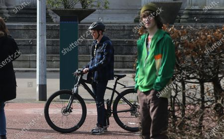 Actor Otto Farrant, who plays the title role in Alex Rider, on his bike along with co-star Brenock O'Connor who plays Tom Harris, during filming of the second series of the Amazon Prime series in Cardiff